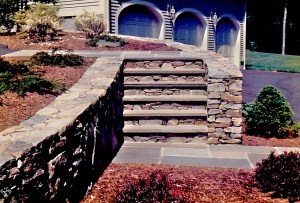 Stone steps, wall, and walkway by Don Nyren Masonry in Southborough, Massachusetts.