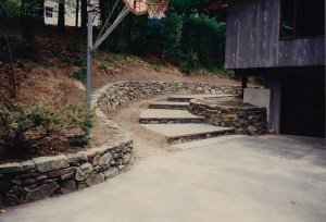 Stone walkway and stone wall by Don Nyren Masonry.