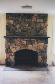 Stone fireplace in Weston, Massachusetts.
