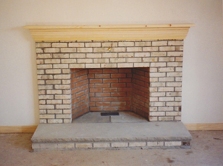 White Painted Brick Fireplace Wall
