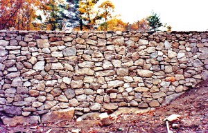 Massive stone wall by Don Nyren Masonry.