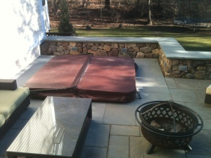 In-ground  hot tub, bluestone patio, and stone wall by Don Nyren Masonry.