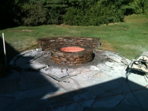 Outdoor brick fire pit by Don Nyren Masonry.